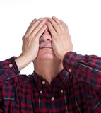 Senior man suffering from a headache Stock Photos