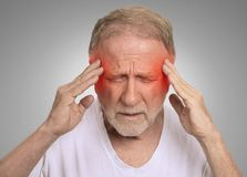 Senior man suffering from headache hands on head Stock Photos