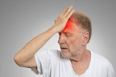 Senior man suffering from headache hands on head Stock Photography