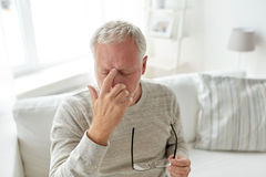 Senior man suffering from headache at home Stock Images