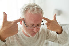 Senior man suffering from headache at home Royalty Free Stock Photography