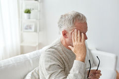 Senior man suffering from headache at home Royalty Free Stock Images