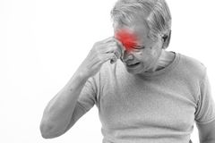 Senior man suffering from headache, stress, migraine stock image