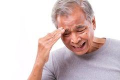 Senior man suffering from headache, stress, migraine Stock Image