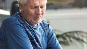 Senior man suffering from leg pain. stock footage