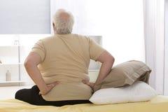 Senior man suffering from lumbago. Overweight senior Man suffering from backache Stock Photography