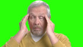Senior man suffering from migraine, green screen. stock video footage