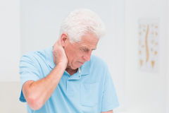 Senior man suffering from neck ache Royalty Free Stock Images