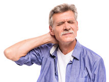 Senior man. Is suffering from neck pain stock images