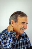 Senior Man Suffering With Severe Neck Pain Stock Photography
