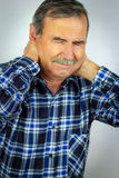 Senior Man Suffering With Severe Neck Pain Stock Photos