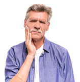 Senior man. Is suffering from tooth pain royalty free stock photos
