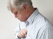 Senior man suffers from bad heartburn