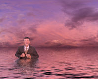 Senior man in suit in deep water Royalty Free Stock Photos