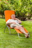 Senior man in sunbed Stock Image