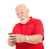 Senior Man - Surprising Text Message Stock Images