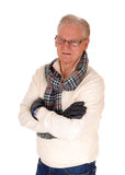 Senior man in sweater and cloves. Royalty Free Stock Photography