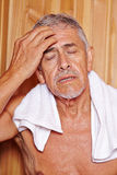 Senior man sweating in hotel sauna Royalty Free Stock Image