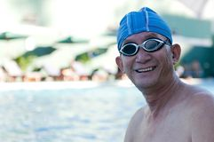 Senior man in swimming pool Royalty Free Stock Images