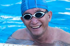 Senior man in swimming pool Royalty Free Stock Photos