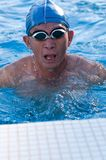 Senior man in swimming pool Stock Image