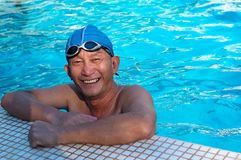 Senior man in swimming pool Stock Photos