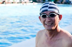 Senior man in swimming pool Royalty Free Stock Photo