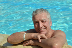 Senior man in a swimming pool Stock Image