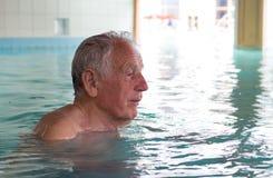 Senior man in swimming pool Stock Photography