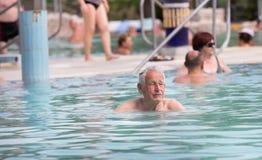 Senior man in swimming pool royalty free stock photo
