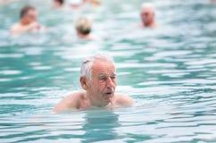 Senior man in swimming pool Royalty Free Stock Image