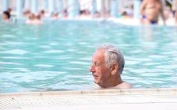 Senior man in swimming pool Royalty Free Stock Photos