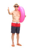 Senior man with a swimming ring giving a thumb up Stock Images