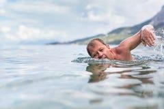 Senior man swimming in the Sea/Ocean Royalty Free Stock Image