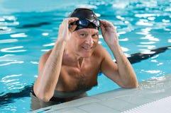 Senior man swimming Stock Photo