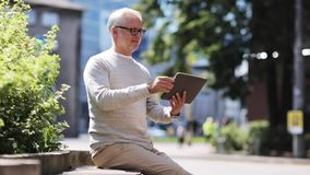 Senior man with tablet pc on city street stock footage