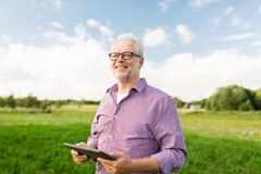 Senior man with tablet pc computer at county Stock Image