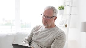 Senior man with tablet pc at home 6 stock footage