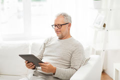 Senior man with tablet pc at home Royalty Free Stock Images