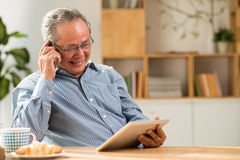 Senior man with tablet and smartphone Stock Image