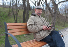 Senior man with a tablet Stock Photo