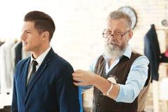 Senior man tailoring formal suit for businessman Stock Images