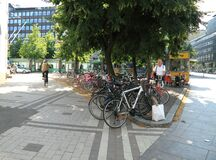 Senior man takes a bicycle from bicycles parking