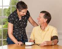 Senior man taking blood pressure with wife royalty free stock photography