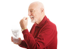 Senior Man - Taking Fish Oil Royalty Free Stock Photography