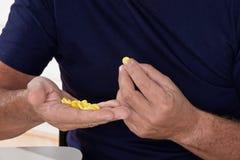 Senior Man taking her Pills Stock Images
