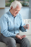 Senior man taking medicament Stock Image