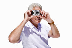 senior man taking photograph on camera, cut out Stock Photography