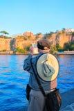 Senior man taking photos on mobile phone Marina Grande Sorrento. Senior man taking photos on mobile phone in Marina Grande in Sorrento, Tyrrhenian sea, Amalfi Royalty Free Stock Photos