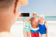 Senior man taking picture of his friends Stock Images